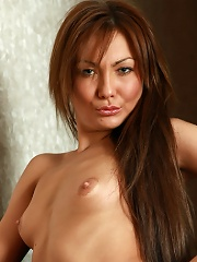 Seductive petite erotic model takes off her panties and bra